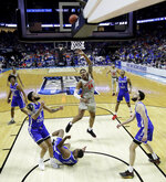 Houston's Breaon Brady (24) gets past a group of Georgia State defenders to put up a shot during the second half of a first round men's college basketball game in the NCAA Tournament Friday, March 22, 2019, in Tulsa, Okla. (AP Photo/Charlie Riedel)
