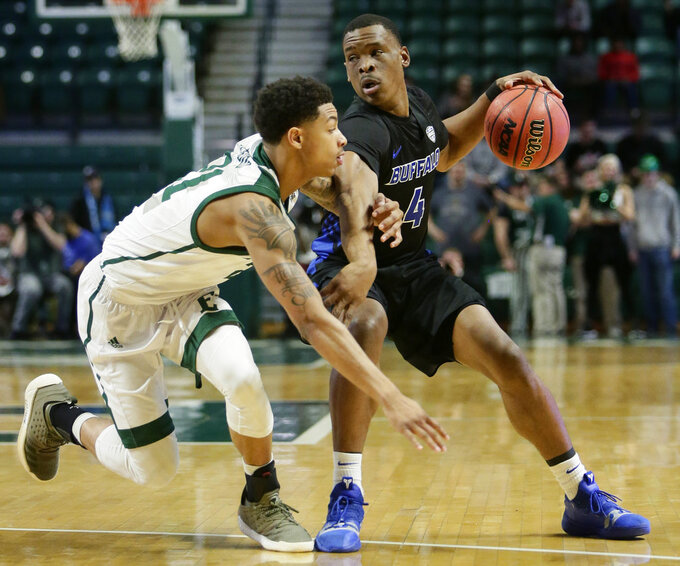 Buffalo guard Davonta Jordan (4) tries to keep Eastern Michigan guard Kevin McAdoo, left, off the ball during the first half of an NCAA college basketball game Friday, Jan. 4, 2019, in Ypsilanti, Mich. (AP Photo/Duane Burleson)