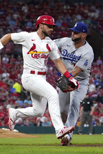 St. Louis Cardinals shortstop Paul DeJong, left, is tagged out by Los Angeles Dodgers first baseman Albert Pujols during the second inning of a baseball game Tuesday, Sept. 7, 2021, in St. Louis. (AP Photo/Jeff Roberson)