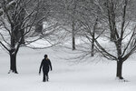 A woman walks in Loose Park Friday, Jan. 24, 2020 in Kansas City, Mo. after a winter storm dumped 1-2 inches of snow on the area overnight. (AP Photo/Charlie Riedel)