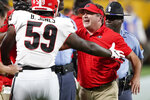 Georgia coach Kirby Smart celebrates the team's win against Clemson in an NCAA college football game Saturday, Sept. 4, 2021, in Charlotte, N.C. (AP Photo/Chris Carlson)