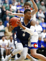 Nevada Wolf Pack forward Tre'Shawn Thurman, front, drives past Colorado State Rams forward Adam Thistlewood during the first half of an NCAA college basketball game Wednesday, Feb. 6, 2019, in Fort Collins, Colo. (AP Photo/David Zalubowski)