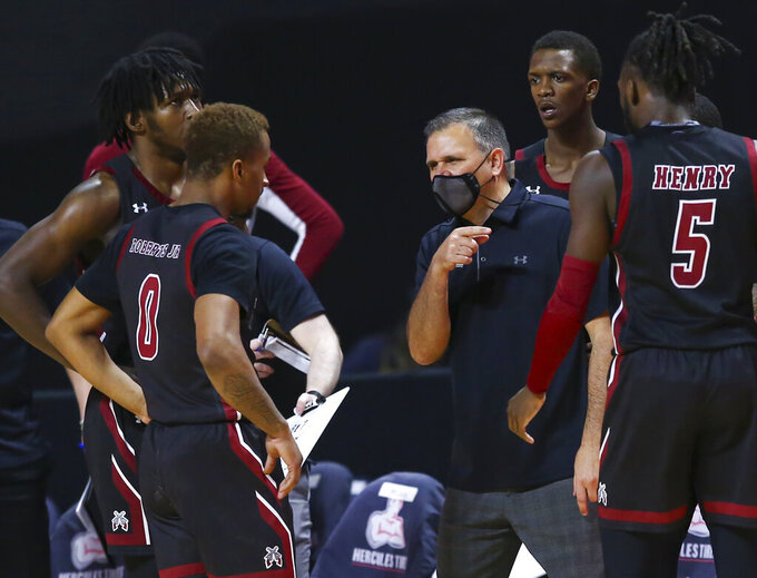New Mexico State coach Chris Jans talks with the team during the second half of an NCAA college basketball game against Grand Canyon for the championship of the Western Athletic Conference men's tournament Saturday, March 13, 2021, in Las Vegas. (AP Photo/Chase Stevens)