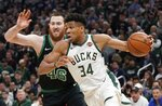 Milwaukee Bucks' Giannis Antetokounmpo drives during the first half of Game 1 of a second round NBA basketball playoff series against the Boston Celtics Sunday, April 28, 2019, in Milwaukee. (AP Photo/Morry Gash