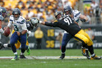 Seattle Seahawks quarterback Russell Wilson (3) scrambles away from Pittsburgh Steelers defensive end Cameron Heyward (97) on his way to a first down in the second half of an NFL football game, Sunday, Sept. 15, 2019, in Pittsburgh. (AP Photo/Don Wright)