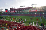 The sun rises over Raymond James Stadium as the Tampa Bay Buccaneers take the field for an NFL football training camp practice Friday, Aug. 28, 2020, in Tampa, Fla. (AP Photo/Chris O'Meara)