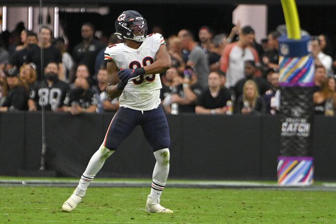 Chicago Bears linebacker Trevis Gipson (99) celebrates after sacking Las Vegas Raiders quarterback Derek Carr (4) during the second half of an NFL football game, Sunday, Oct. 10, 2021, in Las Vegas. (AP Photo/David Becker)