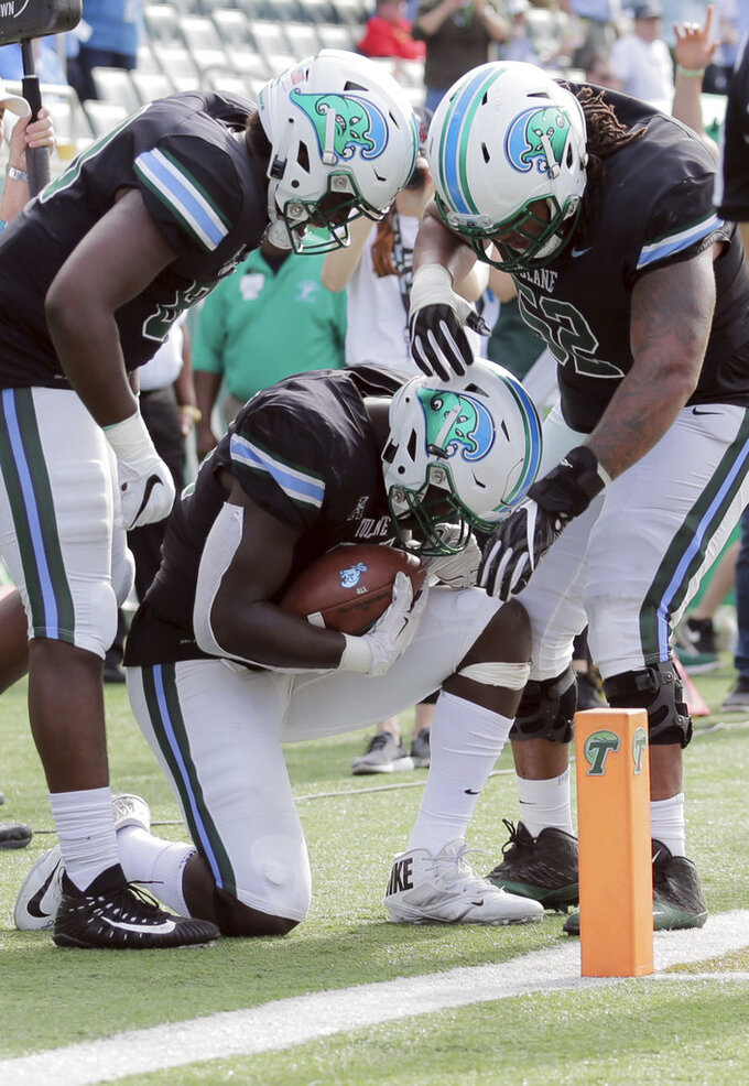 Tulane tight end Charles Jones II (84) says a prayer after catching the ball on a two-point conversion to beat Navy  in an NCAA college football game at Yulman Stadium in New Orleans, Saturday, Nov. 24, 2018. (David Grunfeld/The Times-Picayune via AP)