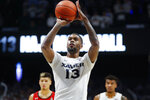 Xavier's Naji Marshall takes a foul shot during the second half of an NCAA college basketball game against Cincinnati, Saturday, Dec. 7, 2019, in Cincinnati. (AP Photo/John Minchillo)