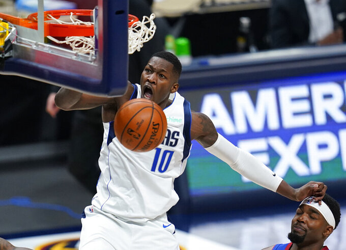 Dallas Mavericks forward Dorian Finney-Smith (10) dunks against the Denver Nuggets during the second quarter of an NBA basketball game Thursday, Jan. 7, 2021, in Denver. (AP Photo/Jack Dempsey)