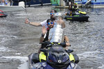 Tampa Bay Lightning left wing Alex Killorn and right wing Nikita Kucherov, rear, carry the Stanley Cup on a personal watercraft during the NHL hockey Stanley Cup champions' Boat Parade, Monday, July 12, 2021, in Tampa, Fla. (AP Photo/Phelan M. Ebenhack)