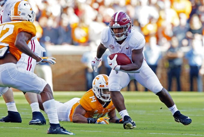 Alabama running back Josh Jacobs (8) runs for yardage as he is missed by Tennessee linebacker Quart'e Sapp (14) in the first half of an NCAA college football game Saturday, Oct. 20, 2018, in Knoxville, Tenn. (AP Photo/Wade Payne)