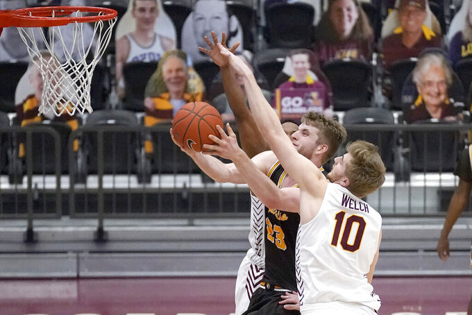 Valparaiso's Ben Krikke (23) drives to the basket past Loyola Chicago's Tom Welch (10) during the first half of an NCAA college basketball game Wednesday, Feb. 17, 2021, in Chicago. (AP Photo/Charles Rex Arbogast)