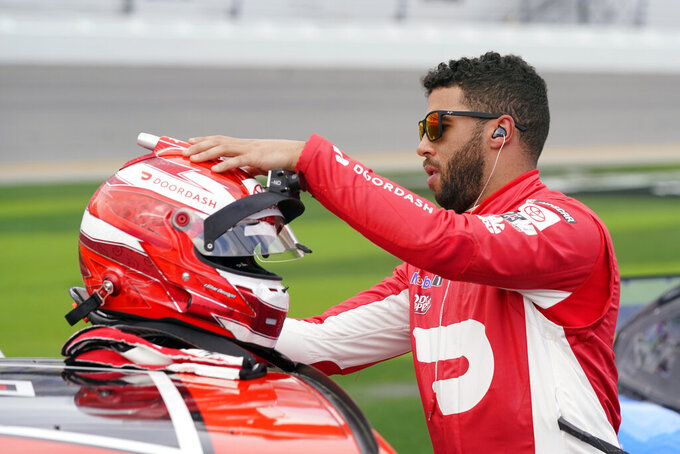 Bubba Wallace checks his helmet before the NASCAR Daytona 500 auto race at Daytona International Speedway, Sunday, Feb. 14, 2021, in Daytona Beach, Fla. (AP Photo/John Raoux)