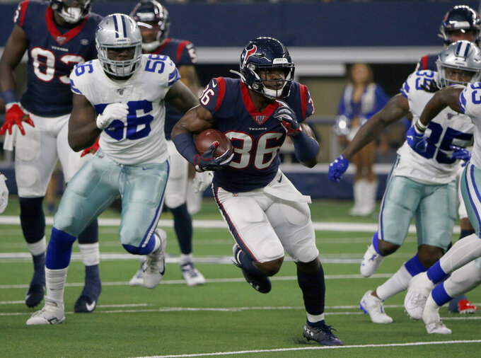 Houston Texans running back Damarea Crockett (36) finds running room as Dallas Cowboys defensive end Joe Jackson (56) pursues in the first half of a preseason NFL football game in Arlington, Texas, Saturday, Aug. 24, 2019. (AP Photo/Michael Ainsworth)
