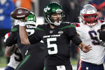 FILE - In this Monday, Nov. 9, 2020, file photo, New York Jets quarterback Joe Flacco throws during the first half of an NFL football game against the New England Patriots in East Rutherford, N.J. The Los Angeles Chargers host the winless Jets on Sunday, in a midseason matchup of struggling teams. (AP Photo/Bill Kostroun, File)