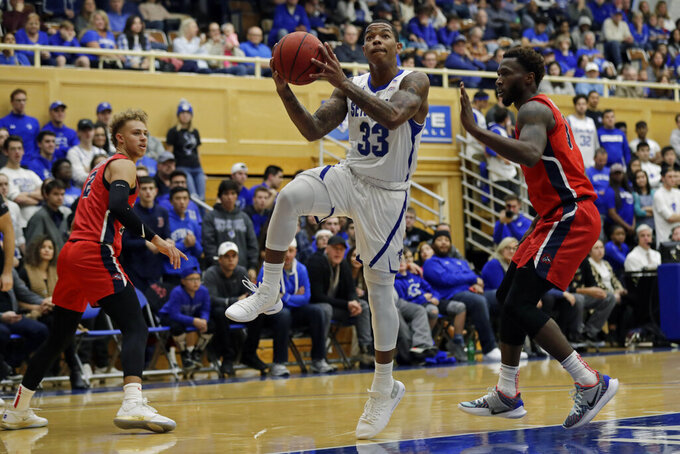 Seton Hall guard Shavar Reynolds (33) drives to the basket past Stony Brook guard Elijah Olaniyi (3) during the first half of an NCAA college basketball game Saturday, Nov. 9, 2019, in South Orange, N.J. (AP Photo/Adam Hunger)