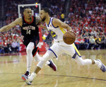 Golden State Warriors guard Stephen Curry (30) drives around Houston Rockets guard Gerald Green (14) during the first half of Game 1 of the NBA basketball Western Conference Finals, Monday, May 14, 2018, in Houston. (AP Photo/David J. Phillip)