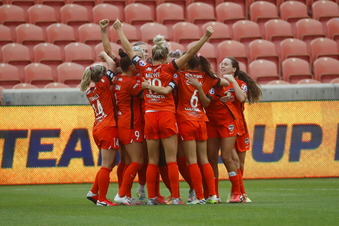 Houston Dash forward Rachel Daly (3) celebrates with her teammates after scoring against the Portland Thorns during the second half of an NWSL Challenge Cup soccer semifinal match Wednesday, July 22, 2020, in Sandy, Utah. (AP Photo/Rick Bowmer)