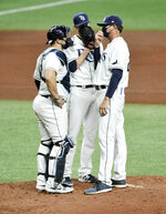 Tampa Bay Rays catcher Mike Zunino, left, and starter Rtyan Yarbrough, center, talks with pitching coach Kyle Snyder on the mound during the sixth inning of a baseball game Wednesday, Aug. 5, 2020, in St. Petersburg, Fla. (AP Photo/Steve Nesius)