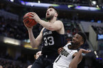 Butler's Bryce Golden (33) puts up a shot against Purdue's Aaron Wheeler (1) during the second half of an NCAA college basketball game, Saturday, Dec. 21, 2019 in Indianapolis. Butler won 70-61. (AP Photo/Darron Cummings)