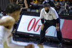 Oakland head coach Greg Kampe stands on the baseline in the first half of an NCAA college basketball game against Oklahoma State in Stillwater, Okla., Saturday, Dec. 5, 2020. (AP Photo/Mitch Alcala)
