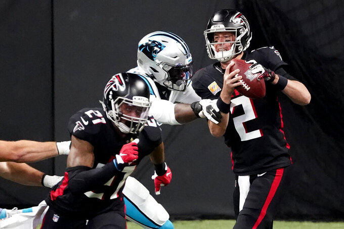 Atlanta Falcons quarterback Matt Ryan (2) works in the pocket against the Carolina Panthers during the first half of an NFL football game, Sunday, Oct. 11, 2020, in Atlanta. (AP Photo/John Bazemore)