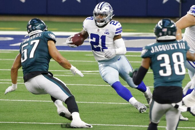 Dallas Cowboys running back Ezekiel Elliott (21) runs the ball as Philadelphia Eagles linebacker T.J. Edwards (57) and cornerback Michael Jacquet (38) close in to make the stop in the second half of an NFL football game in Arlington, Texas, Sunday, Dec. 27. 2020. (AP Photo/Michael Ainsworth)