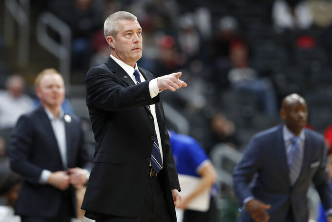 Indiana State head coach Greg Lansing is seen on the sidelines during the first half of an NCAA college basketball game against Missouri State in the quarterfinal round of the Missouri Valley Conference men's tournament Friday, March 6, 2020, in St. Louis. (AP Photo/Jeff Roberson)
