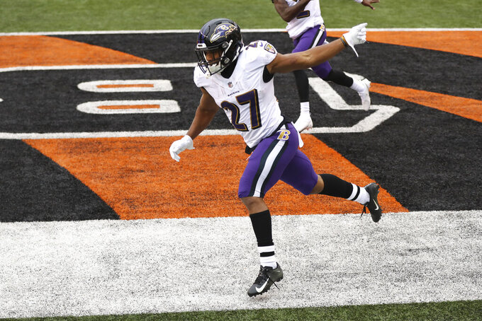 Baltimore Ravens running back J.K. Dobbins (27) celebrates after scoring against the Cincinnati Bengals during the second half of an NFL football game, Sunday, Jan. 3, 2021, in Cincinnati. (AP Photo/Aaron Doster)