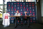 Philadelphia Phillies new manager Joe Girardi, right, listens as Phillies general manager Matt Klentak speaks during a news conference in Philadelphia, Monday, Oct. 28, 2019. The Phillies hired Girardi, the former New York Yankees manager, to replace Gabe Kapler. (AP Photo/Matt Rourke)