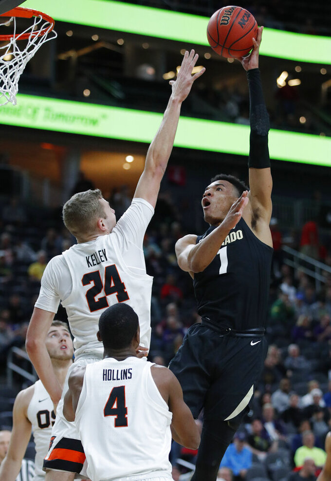 Colorado's Tyler Bey (1) shoots over Oregon State's Kylor Kelley (24) during the first half of an NCAA college basketball game in the quarterfinals of the Pac-12 men's tournament Thursday, March 14, 2019, in Las Vegas. (AP Photo/John Locher)