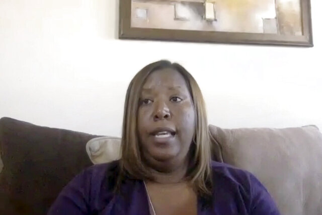 In this image made from a video chat, Monica Shepard responds to questions from a reporter in her home in the Rocky Point area of Pender County, N.C., Tuesday, May 12, 2020. Shepard said she and her son were confronted with an angry group, some of whom were armed, who came to their house in a case of mistaken identity looking for another person whom they believed was involved in a crime. (Cody Jackson/Zoom via AP)