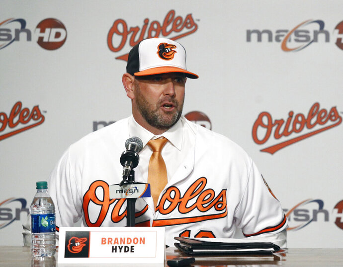 FILE - In this Dec. 17, 2018, file photo, new Baltimore Orioles manager Brandon Hyde speaks at an introductory news conference in Baltimore. There is a manager in the dugout other than Buck Showalter for the first time in nine years, and a new general manager replacing Dan Duquette, who spent seven years with the Orioles. Mike Elias, who was hired in November as Baltimore's new GM, hired Brandon Hyde a month later to succeed Showalter _ and the difference was obvious Tuesday, Feb. 12, 2019. There are few recognizable names, and only a handful of roster spots are accounted for. (AP Photo/Patrick Semansky, File)