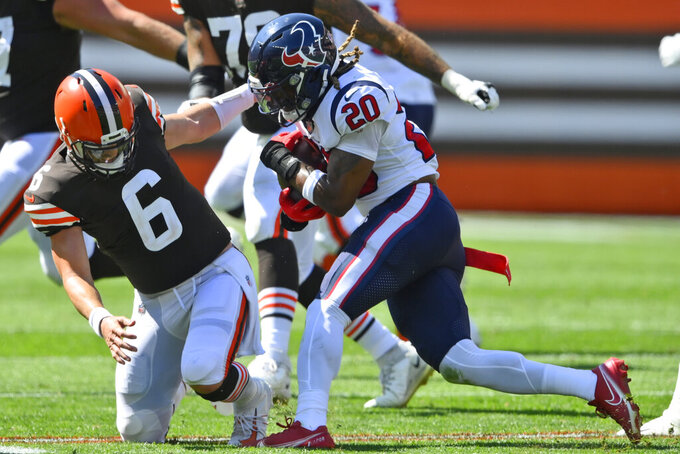 Cleveland Browns quarterback Baker Mayfield (6) is hurt trying to tackle Houston Texans strong safety Justin Reid (20) during the first half of an NFL football game, Sunday, Sept. 19, 2021, in Cleveland. (AP Photo/David Richard)