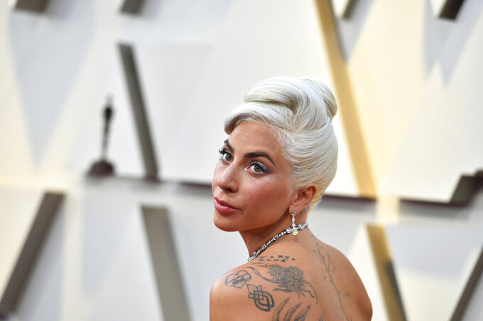 FILE - In this Feb. 24, 2019 file photo, Lady Gaga arrives at the Oscars at the Dolby Theatre in Los Angeles. The market debut of Universal Music Group is a hit with investors optimistic about the future of steaming music. Shares jumped nearly 40% Tuesday, Sept. 21, 2021, to almost $26 per each in trading on the Euronext Amsterdam exchange. Universal has a huge roster of stars including Taylor Swift, Billie Eilish, Lady Gaga, the Beatles and Bob Dylan.   (Photo by Jordan Strauss/Invision/AP, File)