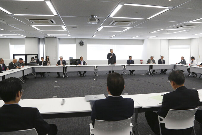"Tokyo 2020 Organizing Committee President Yoshiro Mori, center at rear, speaks during the first meeting of the ""Tokyo 2020 New Launch Task Force"" in Tokyo, Thursday, March 26, 2020, two days after the unprecedented postponement was announced due to the spreading coronavirus. The new Tokyo Olympics need dates for the opening and closing ceremony in 2021. Nothing moves until this is worked out by the International Olympic Committee, the Japanese government, and Tokyo organizers.(AP Photo/Koji Sasahara)"