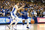 Georgia State's Corey Allen (11) drives against Duke's Alex O'Connell, left, during the first half of an NCAA college basketball game in Durham, N.C., Friday, Nov. 15, 2019. (AP Photo/Ben McKeown)