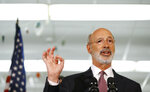 FILE - In this March 21, 2019 file photo, Pennsylvania Gov. Tom Wolf speaks during a news conference at the John H. Taggart School library, in Philadelphia. Wolf has signed numerous executive orders while Democrats' agenda is stalled in the GOP-controlled Legislature, including calling for new gun violence prevention programs. (AP Photo/Matt Slocum, File)