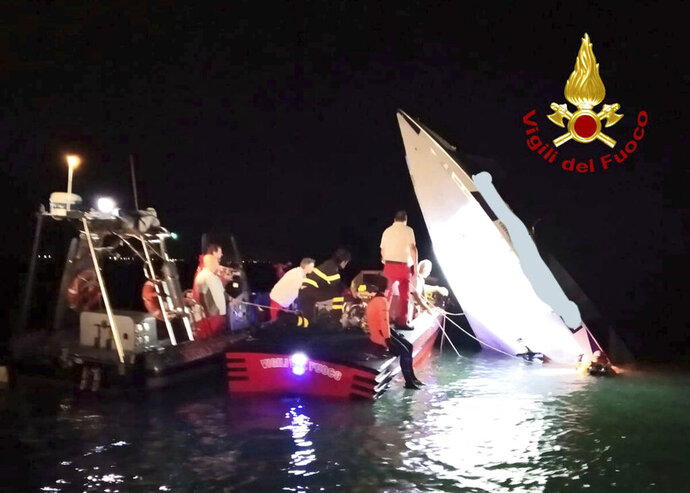 This image provided by firefighters shows the wreckage of a racing boat that allegedly smashed into a dam at the entrance of the Venice laguna, Italy, late Tuesday, Sept. 17, 2019.  Firefighters said one of the men on board was thrown off the boat and was taken to the hospital, the bodies of the three others were found by scuba-divers inside the cabin. According to the Italian news agency ANSA, the men were attempting to break the racing boat record for Monte Carlo to Venice and among the dead was 76-year-old Italian boat racing pilot Fabio Buzzi. (Italian Firefighters via AP)