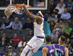 New York Knicks' Mitchell Robinson (26) dunks against the Charlotte Hornets during the first half of an NBA basketball game in Charlotte, N.C., Monday, Jan. 28, 2019. (AP Photo/Chuck Burton)