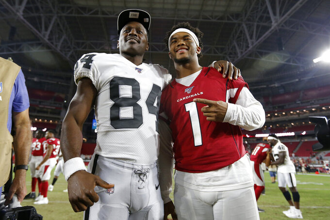 Arizona Cardinals quarterback Kyler Murray (1) and Oakland Raiders wide receiver Antonio Brown (84) meet at midfield after an an NFL preseason football game, Thursday, Aug. 15, 2019, in Glendale, Ariz. The Raiders won 33-26. (AP Photo/Ralph Freso)