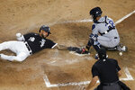 Chicago White Sox's Leury Garcia (28) scores next to Tampa Bay Rays catcher Francisco Mejia on a hit by Danny Mendick and a throwing error by left fielder Randy Arozarena, as home plate umpire James Hoye watches during the fourth inning of a baseball game Tuesday, June 15, 2021, in Chicago. (AP Photo/Charles Rex Arbogast)