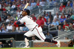 Atlanta Braves' Ozzie Albies watches his RBI double during the first inning of the team's baseball game against the Washington Nationals on Thursday, Sept. 5, 2019, in Atlanta. (AP Photo/John Bazemore)