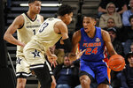 Florida forward Kerry Blackshear Jr. (24) works for a shot as he's defended by Vanderbilt forwards Matthew Moyer (13) and Dylan Disu (1) during an NCAA college basketball game Saturday, Feb. 1, 2020, in Nashville, Tenn. (Wade Payne/The Tennessean via AP)
