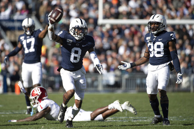 Penn State cornerback Marquis Wilson (8) celebrates after recovering a fumble by Indiana wide receiver Whop Philyor (1) in the second quarter of an NCAA college football game in State College, Pa., on Saturday, Nov.16, 2019. (AP Photo/Barry Reeger)