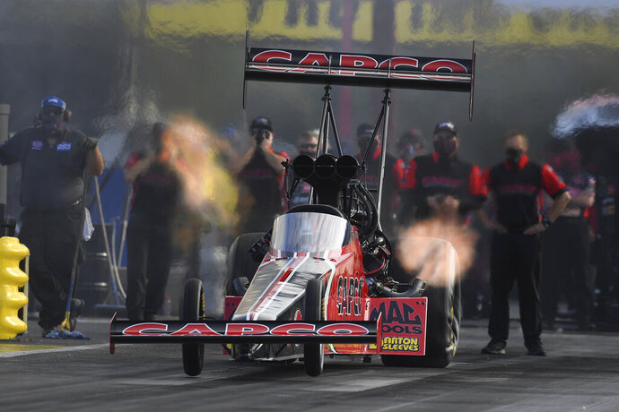 In this photo provided by the NHRA, reigning Top Fuel world champion Steve Torrence earned his third No. 1 qualifier of the season when he raced to a 3.672-second pass at 327.98 mph in his home state of Texas at the Mopar Express Lane NHRA SpringNationals Presented By Pennzoil Saturday, Oct. 24, 2020, in Baytown, Texas. (Marc/NHRA via AP)