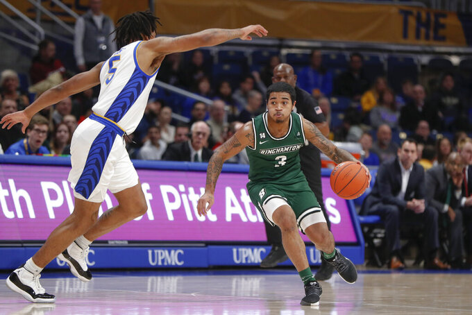 Binghamton's Sam Sessoms (3) drives to the basket as Pittsburgh's Au'Diese Toney (5) defends during the first half of an NCAA college basketball game Friday, Dec. 20, 2019, in Pittsburgh. Pittsburgh won 79-53. (AP Photo/Keith Srakocic)