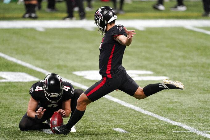 Atlanta Falcons kicker Younghoe Koo (7) of South Korea, kicks a field goal against the Las Vegas Raiders during the first half of an NFL football game, Sunday, Nov. 29, 2020, in Atlanta. (AP Photo/John Bazemore)