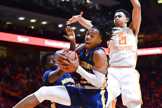 Murray State guard Jason Holliday (45) gets a rebound in front of Tennessee forward Olivier Nkamhoua (21) during an NCAA college basketball game Tuesday, Nov. 12, 2019, in Knoxville, Tenn. (Saul Young/Knoxville News Sentinel via AP)